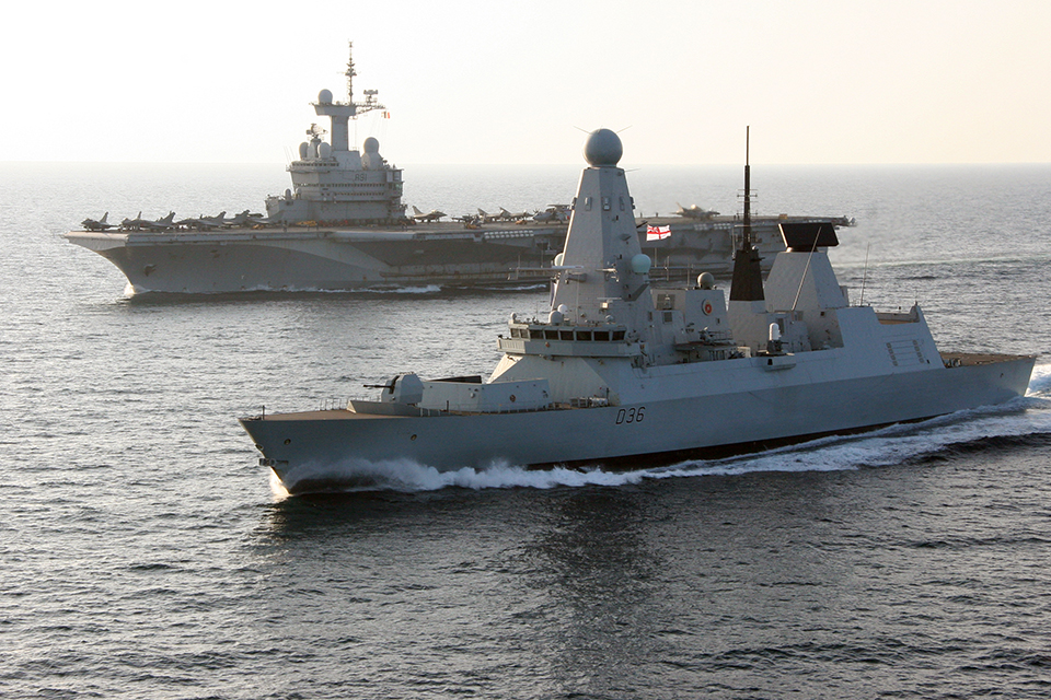 Type 45 destroyer HMS Defender with French aircraft carrier Charles de Gaulle. Crown Copyright.