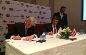 British Ambassador and Minister of Labour signing a Memorandum of Understanding to launch a UK-funded project to help resolve workplace disputes