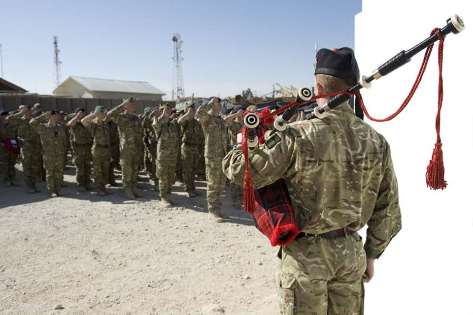 British Service personnel take part in a silent parade to mark Remembrance Sunday at the British base in Lashkar Gah, Helmand province