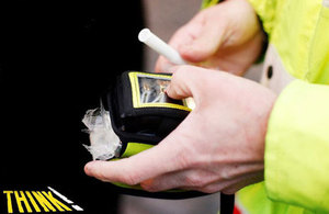 Policeman with breathalyser.
