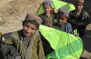 Local Afghan children show off their new kites [Picture: Crown Copyright/MOD 2011]
