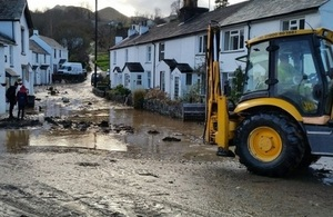 Picture of flood recovery action in Braithwaite.
