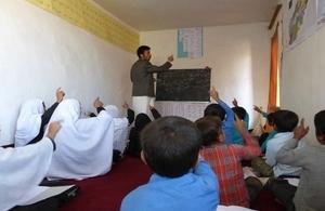 Shabir teaching a class.