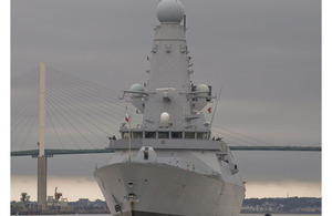 HMS Dauntless sails under the Queen Elizabeth II Bridge at Dartford