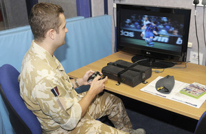 A serviceman uses one of the Xbox consoles at Brize Norton's newly-improved air terminal