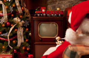 Santa watching TV