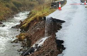 Flood damaged road.