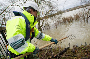 Environment Agency staff clearing flood defences