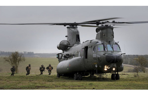 Members of 42 Commando Royal Marines board a Chinook helicopter during Exercise Pashtun Dagger on Salisbury Plain