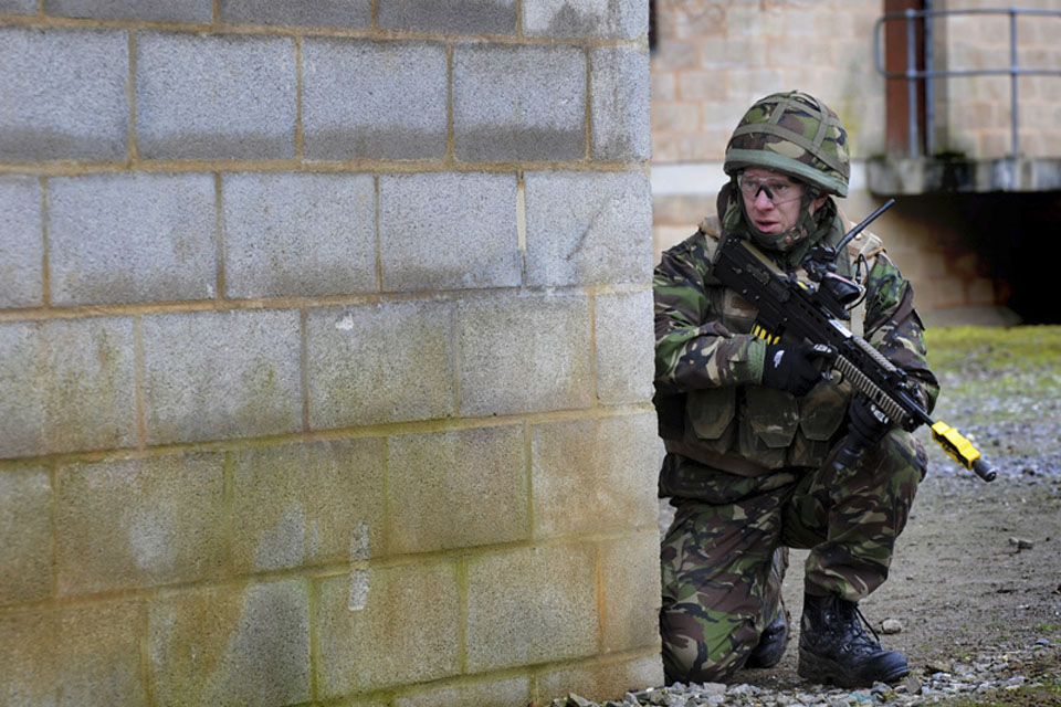 A Royal Marine from 42 Commando takes part in Exercise Pashtun Dagger at Copehill Down Village on Salisbury Plain