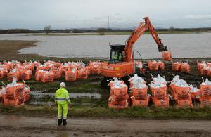 Environment Agency staff repairing breach at Croston, Lancashire