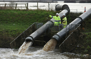 Environment Agency staff with temporary pumps at Mawdesley Pumping Station, Lancashire