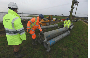 Environment Agency staff installing pumps at Croston, Lancashire to help with ongoing repairs to flood defences.