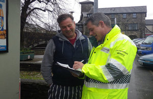 Community support officer talking to residents and businesses in Kendal