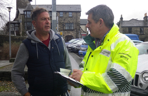Environment Agency flood community support officer talks with member of the public.