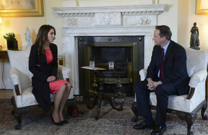 Prime Minister David Cameron talking with Her Majesty, Queen Rania of Jordan inside Number 10 Downing Street.