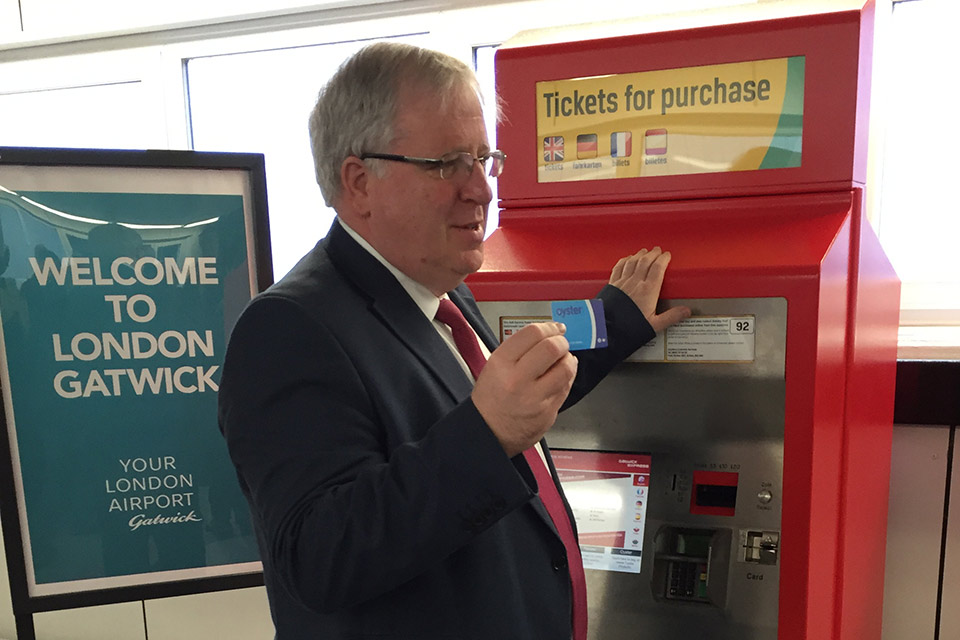 Transport Secretary uses Oyster card at Gatwick Airport.