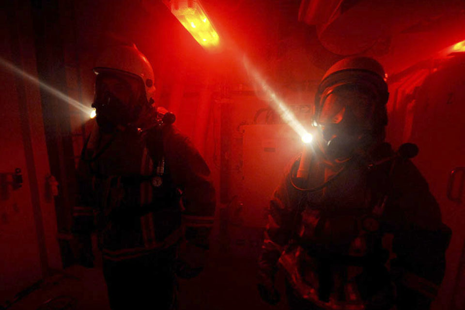 Members of the Fire and Repair Party during a simulated battle damage fire exercise onboard HMS Diamond