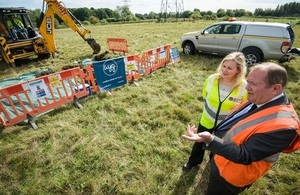 A photograph showing Joanna Larmour, Environment Agency Project Director, and Councillor Rodney Rose, Deputy Leader of Oxfordshire County Council at the ground investigation works happening in autumn 2015.