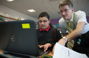 Pupil and teacher using a computer