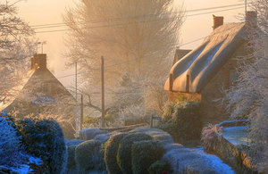 Frost covered houses and gardens.