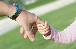 Child holding adult hand