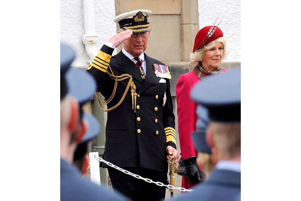 Prince Charles takes the salute from members of the Royal Air Force as they pass by during the Queen's Diamond Jubilee Parade