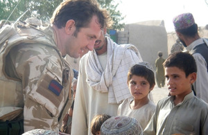 WO2 Chris Davis meets local children
