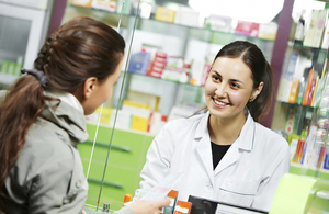 A pharmacist talking to a customer.
