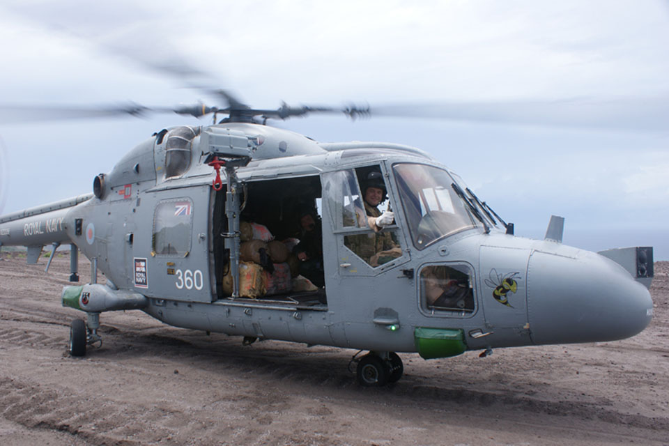 Lieutenant Luke Edwards lands HMS Manchester's Lynx helicopter on Montserrat with the bales of cannabis in the back