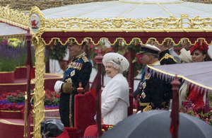Her Majesty The Queen thoroughly enjoying the River Pageant from the Royal Barge alongside HMS President