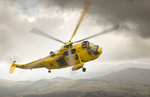 An iconic RAF Sea King Search And Rescue helicopter banks over Snowdonia, North Wales (stock image)