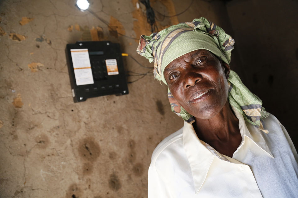 Elizabeth Mukwimba is a 62-year-old Tanzanian woman who now has solar lighting and electricity in her home at the flick of a switch, thanks to a scheme backed by UK aid.