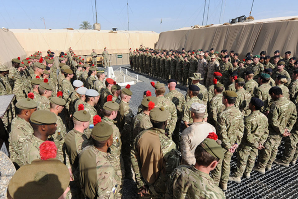 On the front line, at Forward Operating Base Shawqat in Nad 'Ali, Helmand province, soldiers of 3rd Battalion The Royal Regiment of Scotland (The Black Watch) gather in remembrance