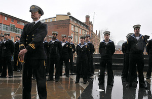 Members of HMS Manchester's ship's company form up outside Manchester Cathedral prior to their march to the Town Hall