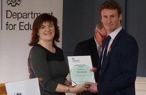 George Hunter receives his award from Secretary of State for Education Nicky Morgan