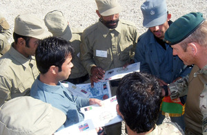 Royal Marines mentoring members of the Afghan Police