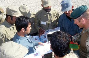 Royal Marines mentoring members of the Afghan Police