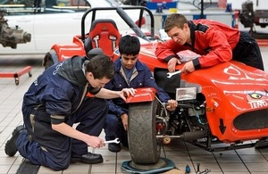 Young people working on car