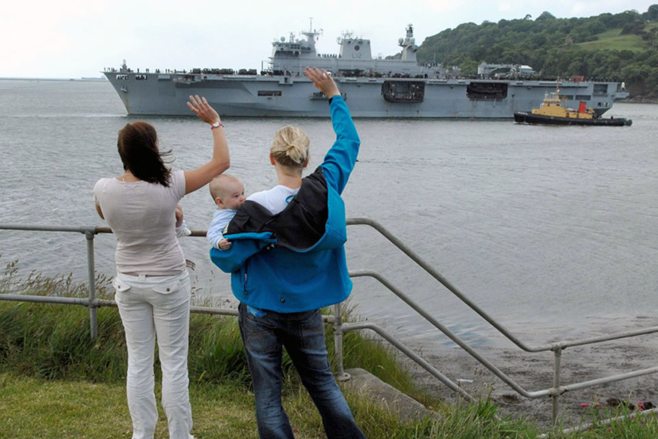 Families wave goodbye to their loved ones aboard HMS Ocean bound for exercises with the United States Marine Corps and Navy
