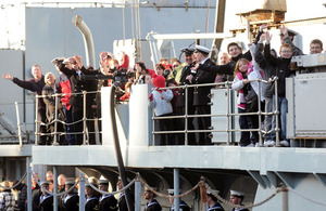 Members of the ship's company and families on board HMS Manchester as she returns to Portsmouth (stock image)