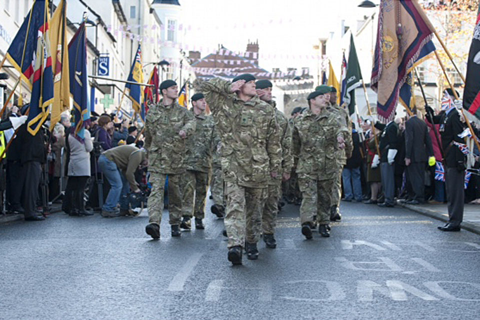 Crowds cheer on soldiers of 1st Battalion The Rifles as they march through Chepstow (stock image)