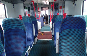 The train interior with visible distortion to the vehicle floor.