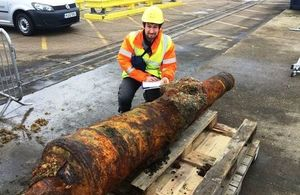 Paolo Croce, Marine Archaeologist, Wessex Archaeology with the recovered cannon at North Quay, Portsmouth International Port. Photo: Gerrit Jan Van Den Bosch/Boskalis Westminster. All rights reserved.