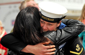 A sailor is welcomed home