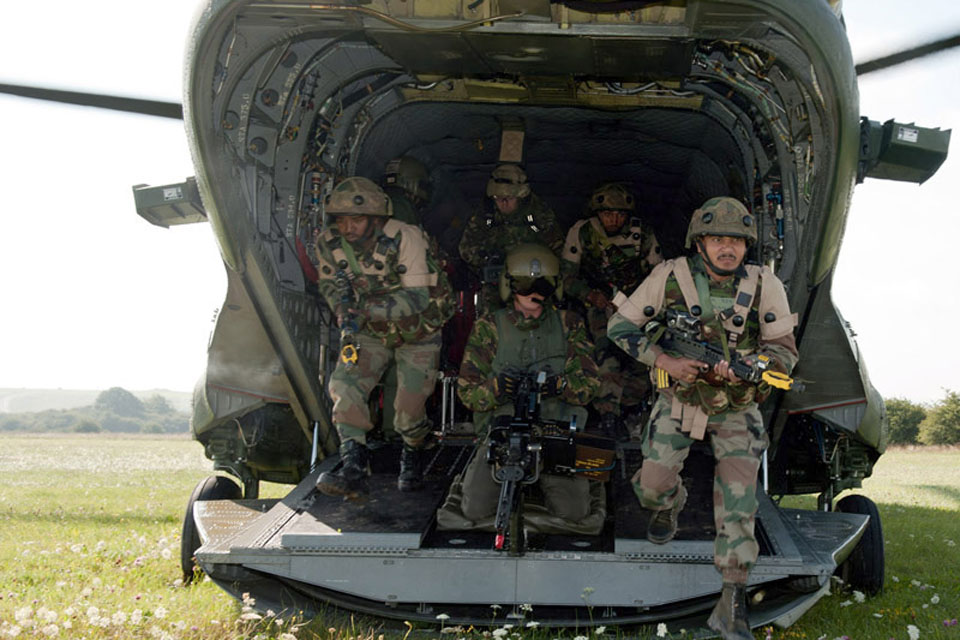 Soldiers from 3rd Battalion The Bihar Regiment disembark from a Chinook helicopter during Exercise Ajeya Warrior on Salisbury Plain