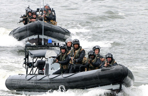 HMS Monmouth's boarding team approach the suspect vessel