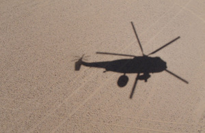 The distinctive shadow of a Sea King Mk7 Airborne Surveillance and Control helicopter
