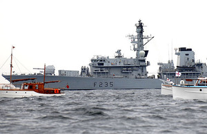 HMS Monmouth sails alongside the Dunkirk Little Ships flotilla to commemorate the 70th anniversary of the World War Two evacuation