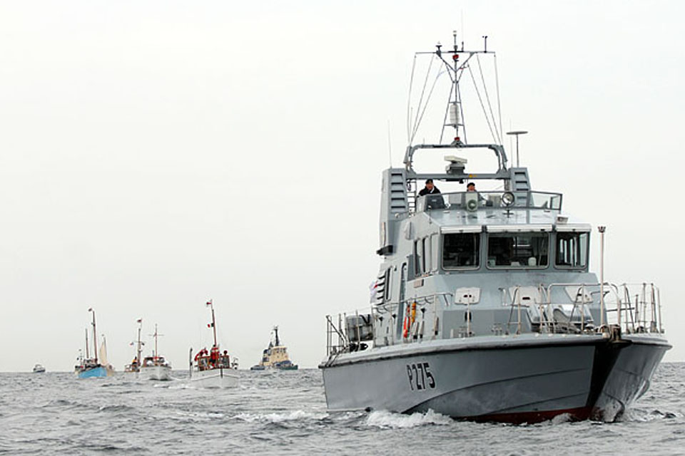 Royal Navy patrol vessel HMS Raider crosses the Channel with boats of the Dunkirk Little Ships flotilla